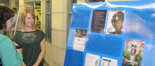 Poster presenter and Human Development and Social Relations student, Erin Thompson, explaining her poster to an attendee at the 2011 Hightower Syposium.