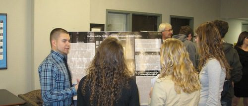 Poster presenter and Anthropology and Sociology student, John Flemming, explaining his poster to attendees at the 2011 Hightower Syposium.