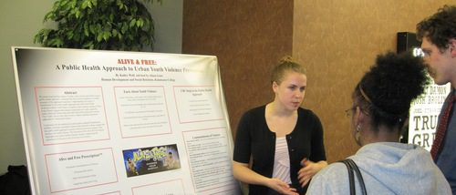 Poster presenter and Human Development and Social Relations student, Kailey Wolf, explaining her poster to students at the 2011 Hightower Syposium.