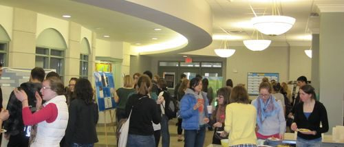 2011 Hightower Symposium attendees partaking in refreshments and speaking with poster presenters.